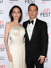 Angelina Jolie and Brad Pitt attend the premiere of