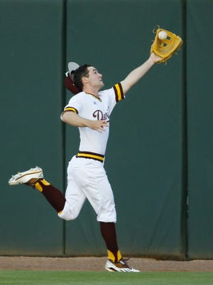 Arizona State right fielder Gage Canning (12) makes a catch  for an out in the first inning of their NCAA baseball game against UNLV  Tuesday Mar. 28, 2017 in Phoenix, Ariz.