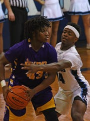 Byrd's Jordan Jeter is guarded by Airline's Brandon Marshall during Tuesday's game at Airline.