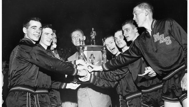 "Original Hoosiers: The Milan High School Indians, state champs, 1954. The film ""Hoosiers"" was based on their story."