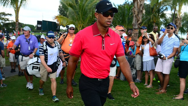 Tiger Woods walks to the 5th tee during the final round of the WGC - Cadillac Championship.