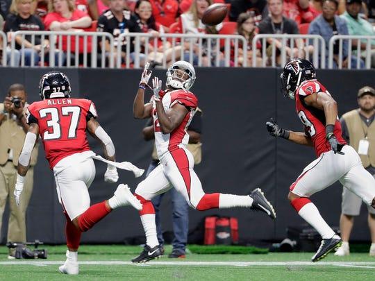 Cardinals wide receiver John Brown (12) makes a touchdown
