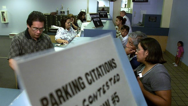 Employees of the El Paso Municipal Court are kept busy as traffic citations are paid all day.
