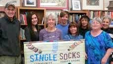 Volunteers help to make Single Socks a very successful non-profit thrift store.