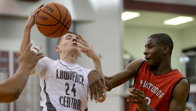 Lawrence CentralÕs Kyle Guy (24) is fouled by Park TudorÕs Jaren Jackson Jr. (32) in the second half of their game Wednesday, Jan 6, 2016, evening at Lawrence Central High School.