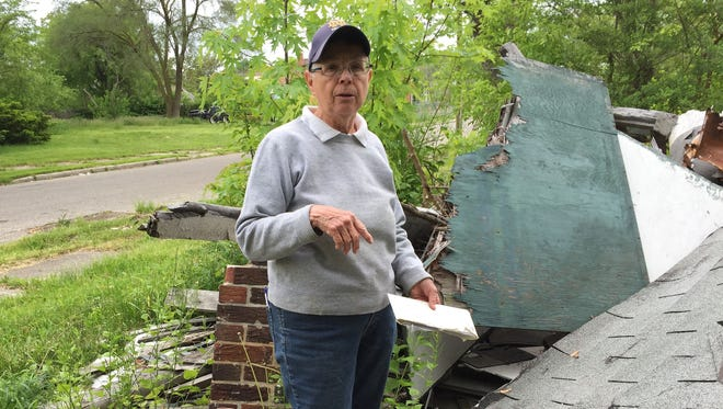 Patricia Kobylski has been trying to get the City of Detroit  to remove a pile of debris left from an illegal demolition in her east-side neighborhood. On Tuesday, she holds an envelope filled with notes on her calls to city officials.