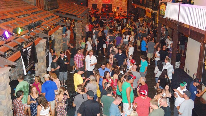 A large crowd attends at the Beat the Heat Winterfest at The Venue in Scottsdale on Saturday, August 25, 2012.