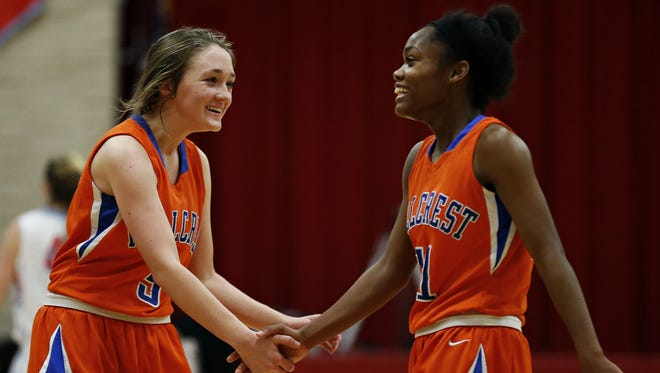 Hillcrest senior Kaycee Gerald (right) shakes hands with freshman Sarah Hale (left) prior to a 2016 game at Glendale High School.