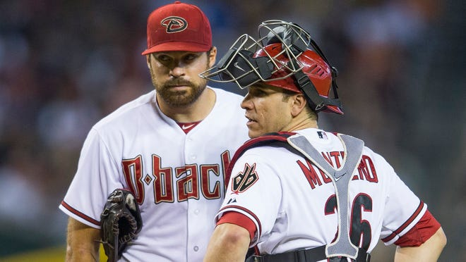 Diamondbacks catcher Miguel Montero talks with Josh Collementer at Chase Field on June 20, 2014.