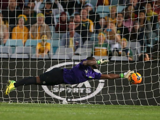 South Africa's Senzo Robert Meyiwa makes a diving save against Australia during their friendly soccer match in Sydney, Monday, May 26, 2014. (AP Photo/Rick Rycroft)