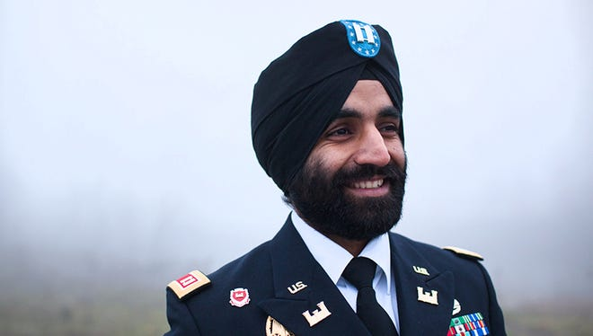 West Point graduate, Bronze Star Medal recipient, and Sikh soldier Captain Simratpal Singh, in his military uniform with the approved turban religious attire.