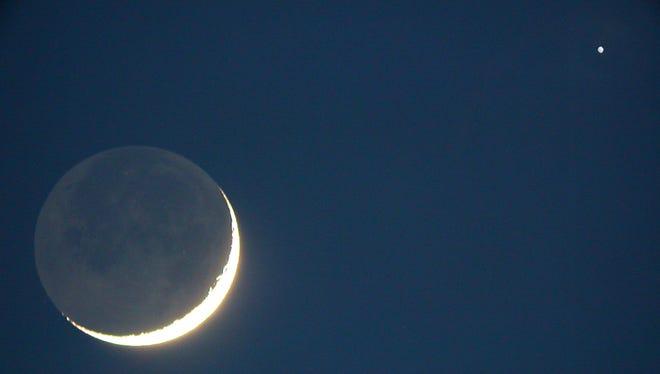 The slim crescent Moon next to the planet Venus