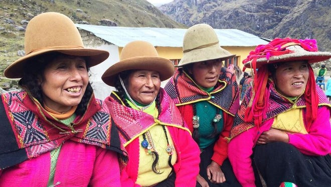 Women from a Q'ero village pose for a photo.