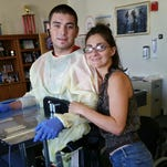 Cal Fire firefighter Damien Pereira, who suffered crippling injuries earlier this month while fighting a fire near Three Rivers, posted this photo of himself standing for the first time in three weeks with the help of a mechanical device. Standing beside him is his wife, Klara.