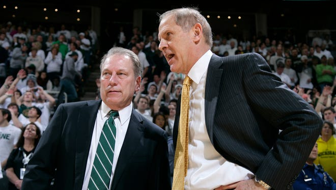 Michigan State basketball coach Tom Izzo, left, and Michigan coach John Beilein talk before a game Feb. 1, 2015, in East Lansing.