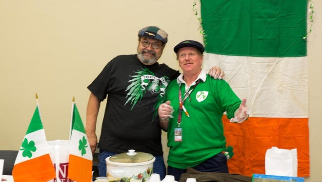 Larry Coalson, left, and Mike Cleary served up an Irish stew at 2013's event.
