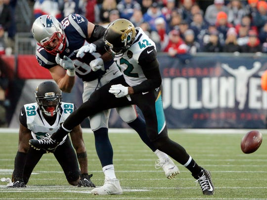Patriots tight end Rob Gronkowski is hit by Jaguars safety Barry Church during the AFC Championship Game.