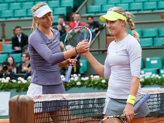 Eugenie Bouchard smiles sheepishly after losin to her idol, Maria Sharapova, at the French Open.