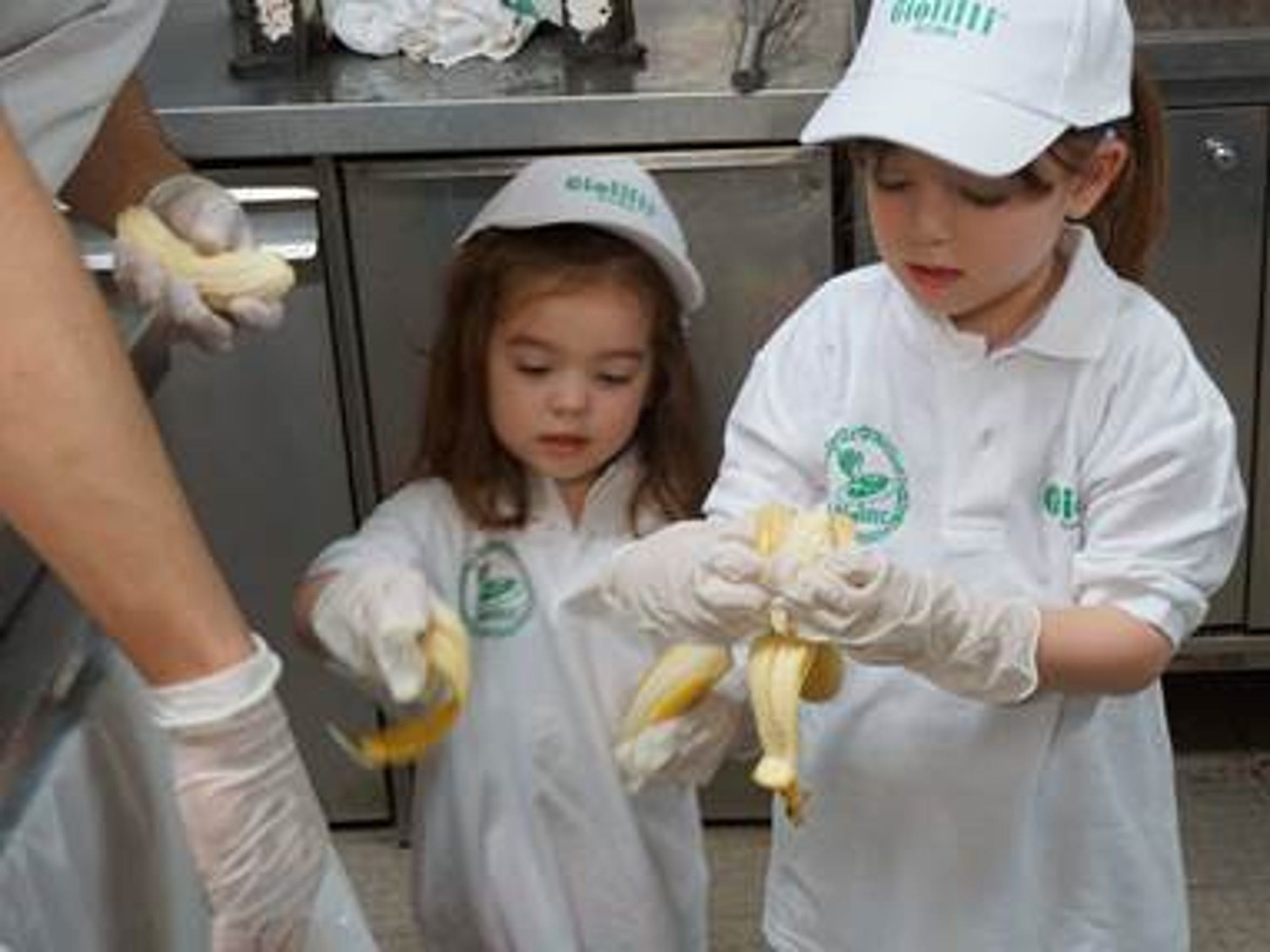 Lizzy Myers and her sister Kayla peel 9 pounds of bananas to make Giolitti's famous banana gelato.