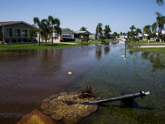 Water floods the Citrus Park community in Bonita Springs