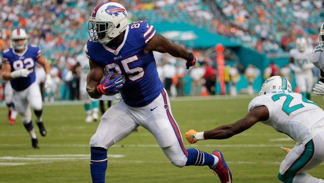 Buffalo Bills tight end Charles Clay (evades a tackle by Miami Dolphins cornerback Brice McCain for a touchdown during the first half.