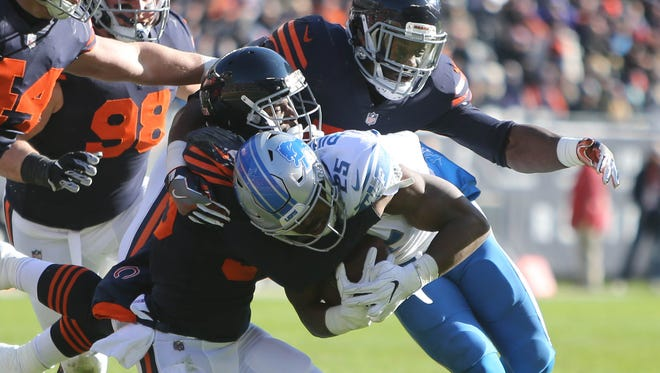 Detroit Lions' Theo Riddick is tackled by Chicago Bears defenders in the second quarter Sunday, Nov. 19, 2017 at Soldier Field in Chicago.