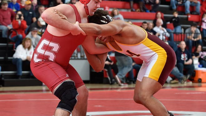 Smyrna's Jake Mitchell won a 4-3 decision in his match as the Eagles routed Sussex Central 49-13 Saturday.