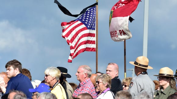 Visitors attend a ceremony at the Flight 93 National Memorial.  A special ceremony was held during the Flight 93 15th Anniversary Observance on Sunday September 11, 2016 at the Flight 93 National Memorial near Shanksville, Pennsylvania.
