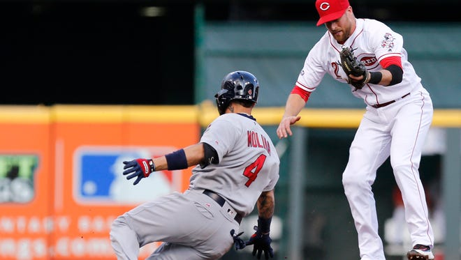 St. Louis Cardinals catcher Yadier Molina (4) slides safely into second base for a double against Cincinnati Reds shortstop Zack Cozart (2) during the second inning at Great American Ball Park.