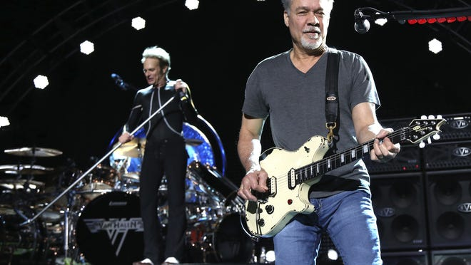 FILE - David Lee Roth, left, and Eddie Van Halen of Van Halen perform on Aug. 13, 2015, in Wantagh, N.Y. Van Halen, who had battled mouth cancer, died Tuesday, Oct. 6, 2020. He was 65.