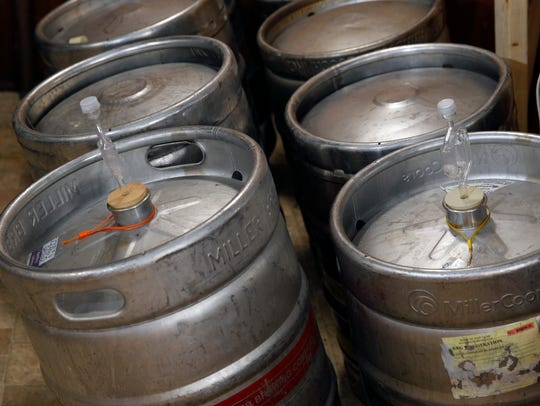 Stainless steel beer kegs are used for fermenting wine