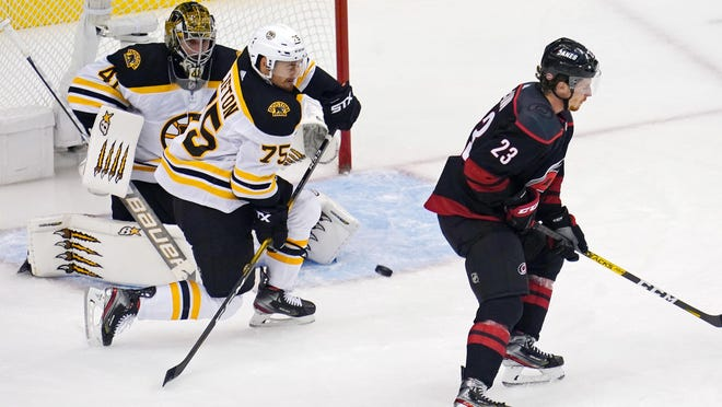 Bruins goaltender Jaroslav Halak and defenseman Connor Clifton (75) defend a shot from the Carolina Hurricanes during Game 3 of their first-round Stanley Cup Playoff series at Scotiabank Arena.