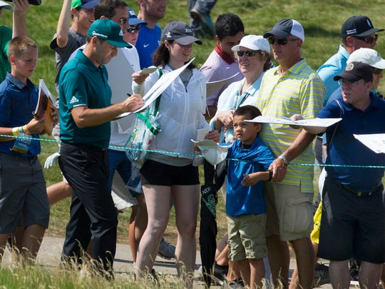 Sergio Garcia signs autographs during a U.S. Open practice round Tuesday at Erin Hills.