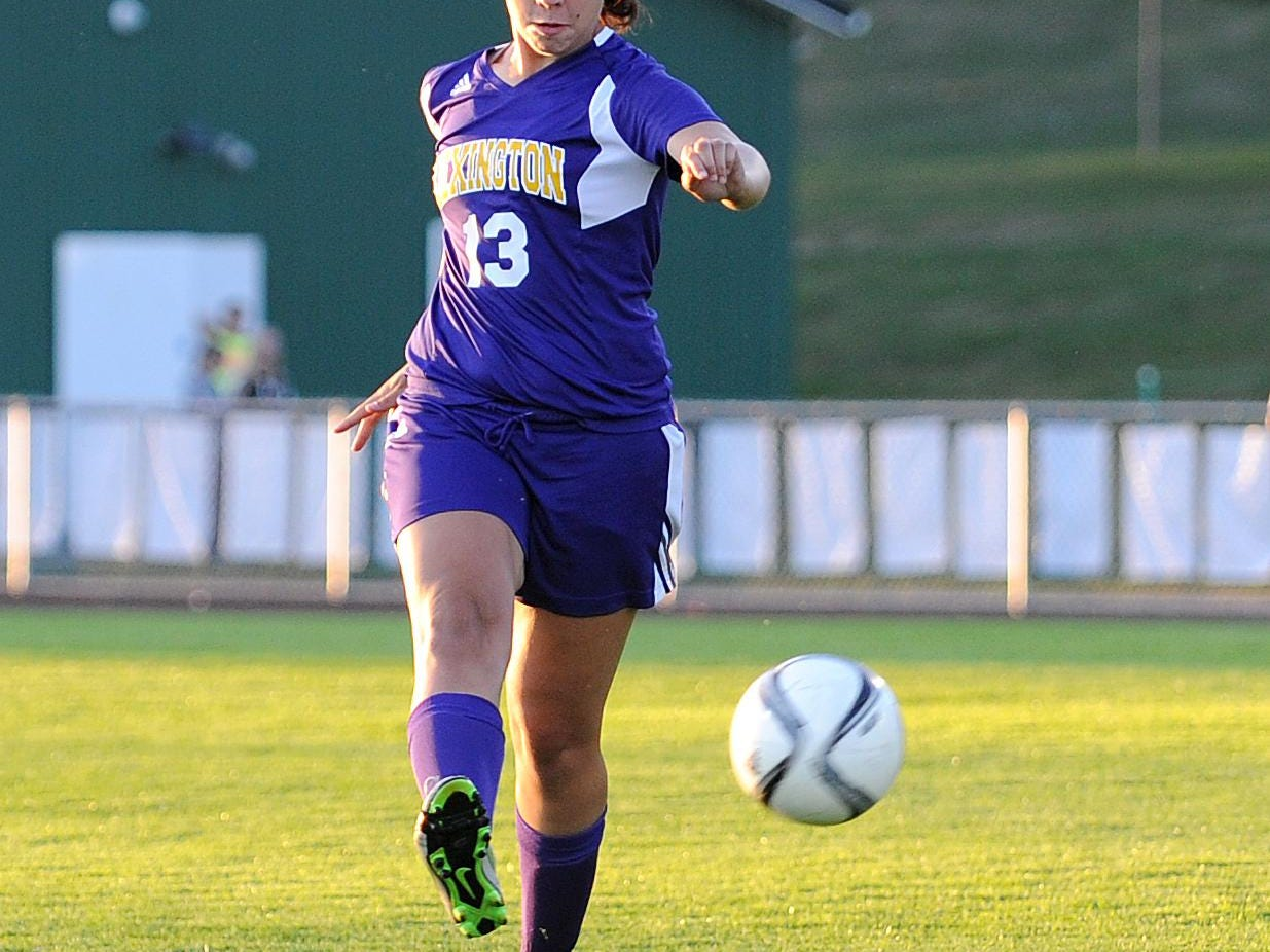 Lexington's Bayley Schonauer keeps the ball away from the goal Tuesday evening during their game against Clear Fork.