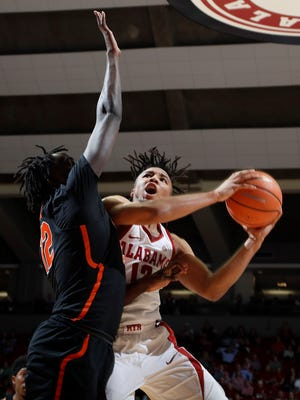 Alabama's Dazon Ingram attempts to score inside against Florida on Feb. 27.