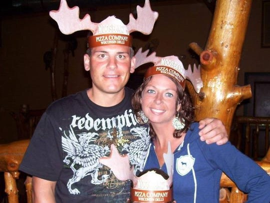 Jason Simcakoski and Heather Fluty Simcakoski of Stevens Point pose with their daughter, Anaya, wearing paper antlers from Moosejaw Pizza in Wisconsin Dells. The 35-year-old former Marine died of an overdose at Tomah VA Medical Center's inpatient care unit in August.