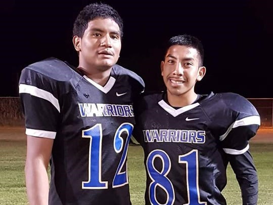 Warren Mattias (left) rushed for 230 yards and four touchdowns on Friday night, while Trajan Johnson caught one touchdown and rushed for another.
