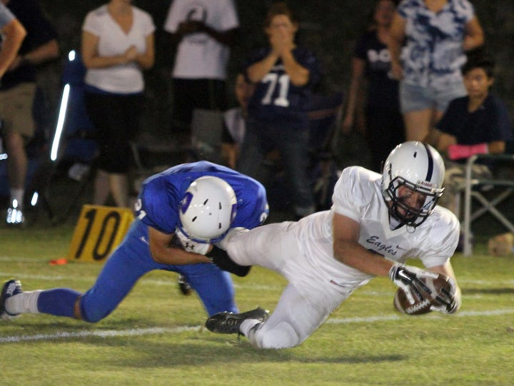 A Desert Chapel ball carrier plunges into the end zone against Desert Christian Academy on Oct. 3.