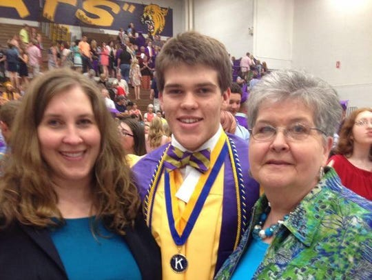 Joseph Tanner Wray, center, died during the Ace Miller Memorial Boxing Tournament in February. Wray was a graduate of Lawrence County High School, where he played football and was selected to be valedictorian. Wray's mother will accept his degree from the University of Tennessee, Knoxville, on Friday.