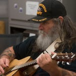 Watch: Veterans learn to play guitar