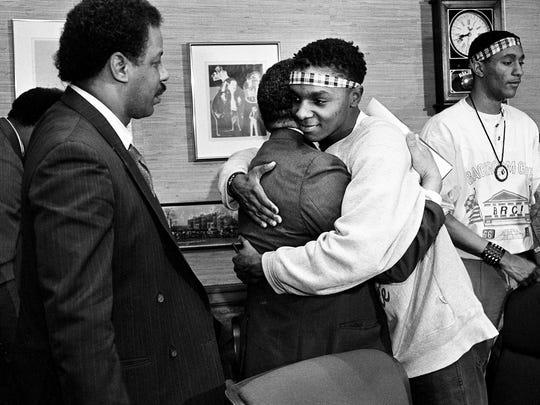 SGA President jeff carr, center right, hugs Tennessee