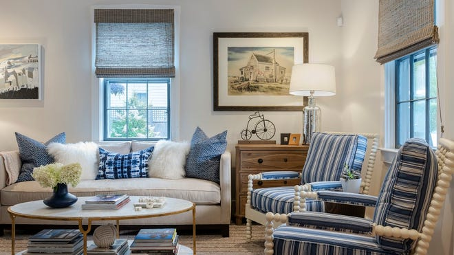Bold blue chairs and matching sofa pillows punctuate the living room's neutral color palette and add to the room's coastal feel. The Paul Kelly painting at the far left was Peter's farewell-to-Provincetown purchase.