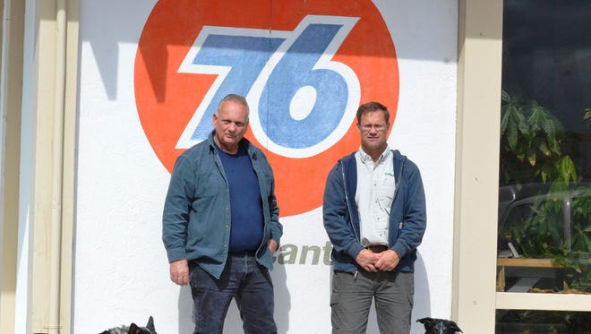 Ron, left, and Jim Menesini stand in front of their Unocal petroleum distributorship office. Jim bought the business last year from his father, Ron.