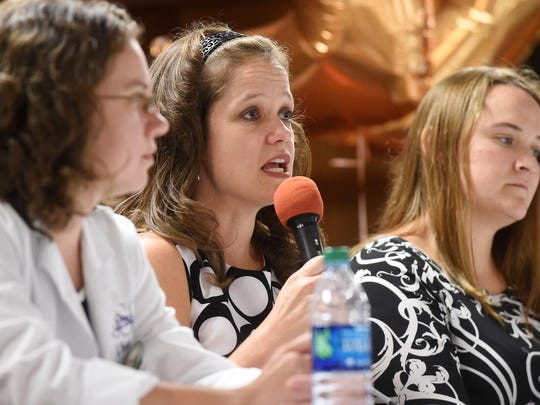 Dr. Rebecca Martin, center, answers a question about pulmonology heath on Thursday during the 7th Annual Women's Health Forum at the Baxter County Fairgrounds.