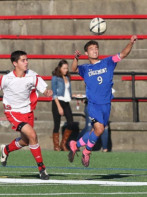 Edgemont's Drew Simon (9) controls a pass in front of Sleepy Hollow's Harry Bogusz  during a boys soccer game at the Washington Irving School in Tarrytown  on Wednesday. Edgemont won the game 1-0.