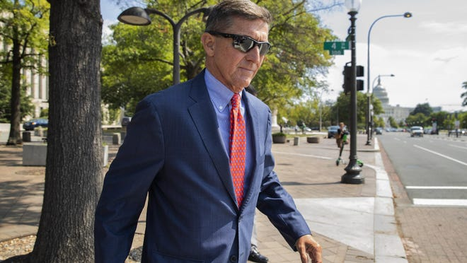 Michael Flynn, President Donald Trump's former national security adviser, leaves the federal court following a status conference with Judge Emmet Sullivan, in Washington, Tuesday, Sept. 10, 2019.