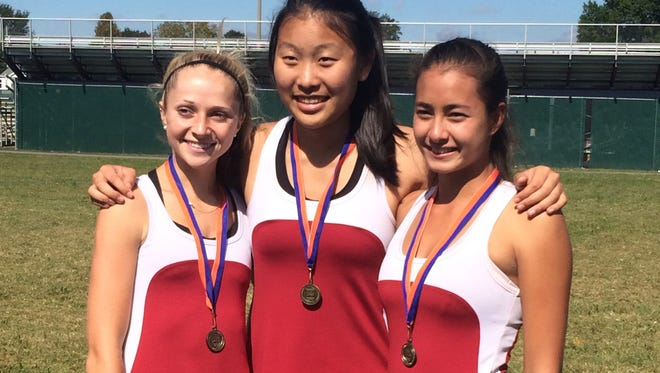 Asheville High's Adrienne Haynes, Kristie Kim and Senna Mucklow were champions at last week's 3-A Western Regional tournament in Hickory.