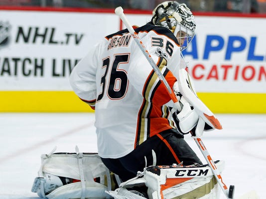 Anaheim Ducks' John Gibson deflects a shot on goal during the second period of an NHL hockey game against the Philadelphia Flyers, Tuesday, Oct. 24, 2017, in Philadelphia. (AP Photo/Tom Mihalek)