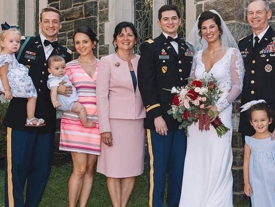 Lt. Gen. Sean B. MacFarland, far right, and Lynda MacFarland,