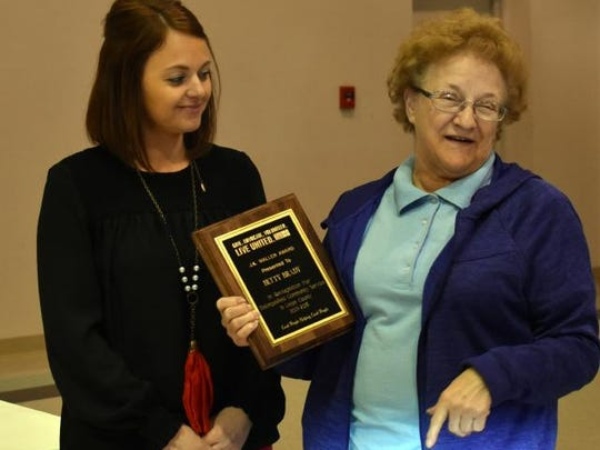 Mary Jo Adams, right, receives the JK Waller  Award